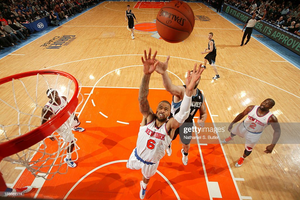 <a gi-track='captionPersonalityLinkClicked' href=/galleries/search?phrase=Tyson+Chandler&family=editorial&specificpeople=202061 ng-click='$event.stopPropagation()'>Tyson Chandler</a> #6 of the New York Knicks rebounds against <a gi-track='captionPersonalityLinkClicked' href=/galleries/search?phrase=Nikola+Pekovic&family=editorial&specificpeople=829137 ng-click='$event.stopPropagation()'>Nikola Pekovic</a> #14 of the Minnesota Timberwolves on December 23, 2012 at Madison Square Garden in New York City.