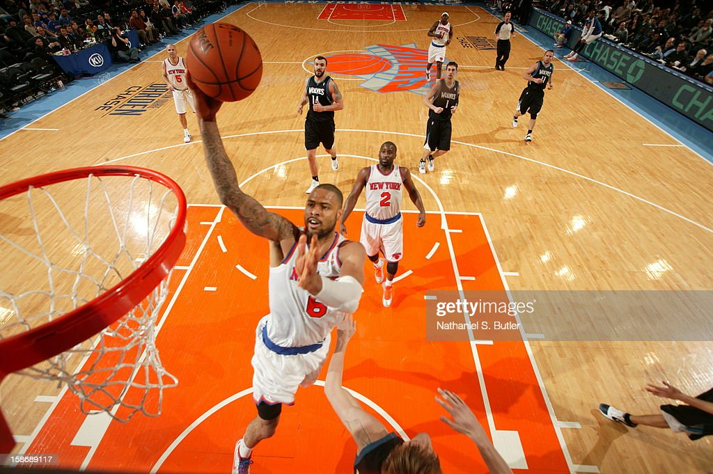 <a gi-track='captionPersonalityLinkClicked' href=/galleries/search?phrase=Tyson+Chandler&family=editorial&specificpeople=202061 ng-click='$event.stopPropagation()'>Tyson Chandler</a> #6 of the New York Knicks shoots against Andre Kirilenko #47 of the Minnesota Timberwolves on December 23, 2012 at Madison Square Garden in New York City.
