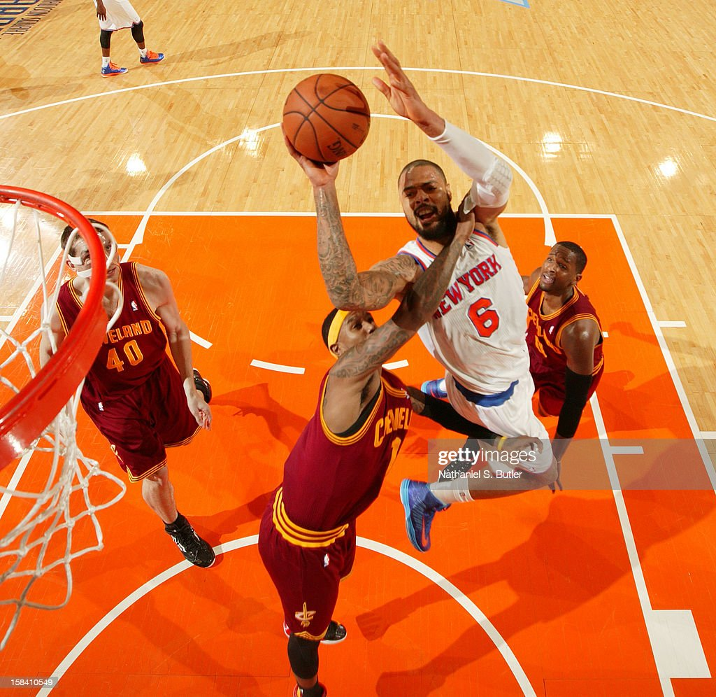 <a gi-track='captionPersonalityLinkClicked' href=/galleries/search?phrase=Tyson+Chandler&family=editorial&specificpeople=202061 ng-click='$event.stopPropagation()'>Tyson Chandler</a> #6 of the New York Knicks shoots against <a gi-track='captionPersonalityLinkClicked' href=/galleries/search?phrase=Daniel+Gibson&family=editorial&specificpeople=213906 ng-click='$event.stopPropagation()'>Daniel Gibson</a> #1 of the Cleveland Cavaliers during game on December 15, 2012 at Madison Square Garden in New York City.