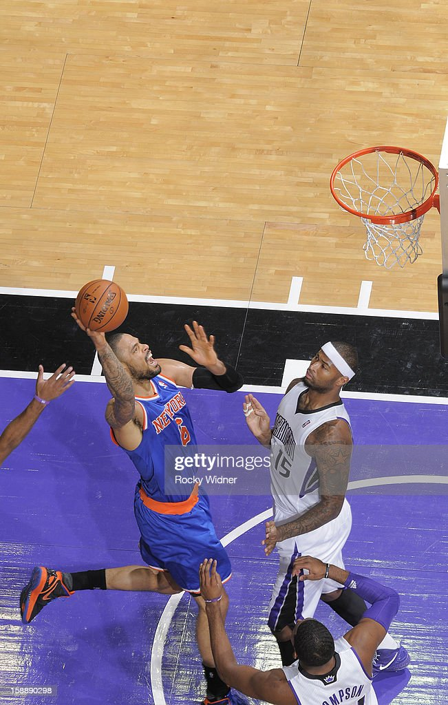 <a gi-track='captionPersonalityLinkClicked' href=/galleries/search?phrase=Tyson+Chandler&family=editorial&specificpeople=202061 ng-click='$event.stopPropagation()'>Tyson Chandler</a> #6 of the New York Knicks shoots against <a gi-track='captionPersonalityLinkClicked' href=/galleries/search?phrase=DeMarcus+Cousins&family=editorial&specificpeople=5792008 ng-click='$event.stopPropagation()'>DeMarcus Cousins</a> #15 of the Sacramento Kings on December 28, 2012 at Sleep Train Arena in Sacramento, California.