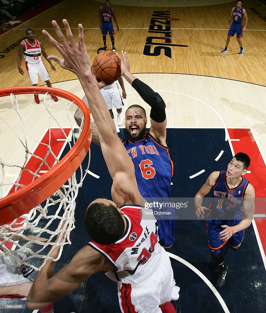 <a gi-track='captionPersonalityLinkClicked' href=/galleries/search?phrase=Tyson+Chandler&family=editorial&specificpeople=202061 ng-click='$event.stopPropagation()'>Tyson Chandler</a> #6 of the New York Knicks shoots against <a gi-track='captionPersonalityLinkClicked' href=/galleries/search?phrase=JaVale+McGee&family=editorial&specificpeople=4195625 ng-click='$event.stopPropagation()'>JaVale McGee</a> #34 of the Washington Wizards during the game at the Verizon Center on February 8, 2012 in Washington, DC.