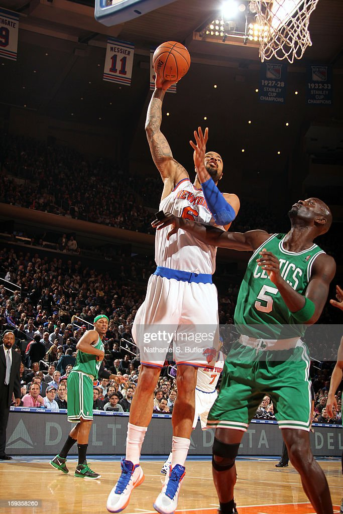 Tyson Chandler #6 of the New York Knicks shoots against Kevin Garnett #5 of the Boston Celtics on January 7, 2013 at Madison Square Garden in New York City.