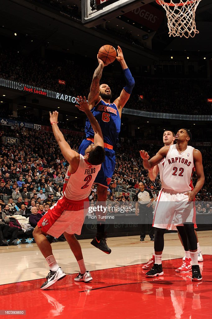 <a gi-track='captionPersonalityLinkClicked' href=/galleries/search?phrase=Tyson+Chandler&family=editorial&specificpeople=202061 ng-click='$event.stopPropagation()'>Tyson Chandler</a> #6 of the New York Knicks shoots against <a gi-track='captionPersonalityLinkClicked' href=/galleries/search?phrase=Landry+Fields&family=editorial&specificpeople=4184645 ng-click='$event.stopPropagation()'>Landry Fields</a> #2 of the Toronto Raptors on February 22, 2013 at the Air Canada Centre in Toronto, Ontario, Canada.