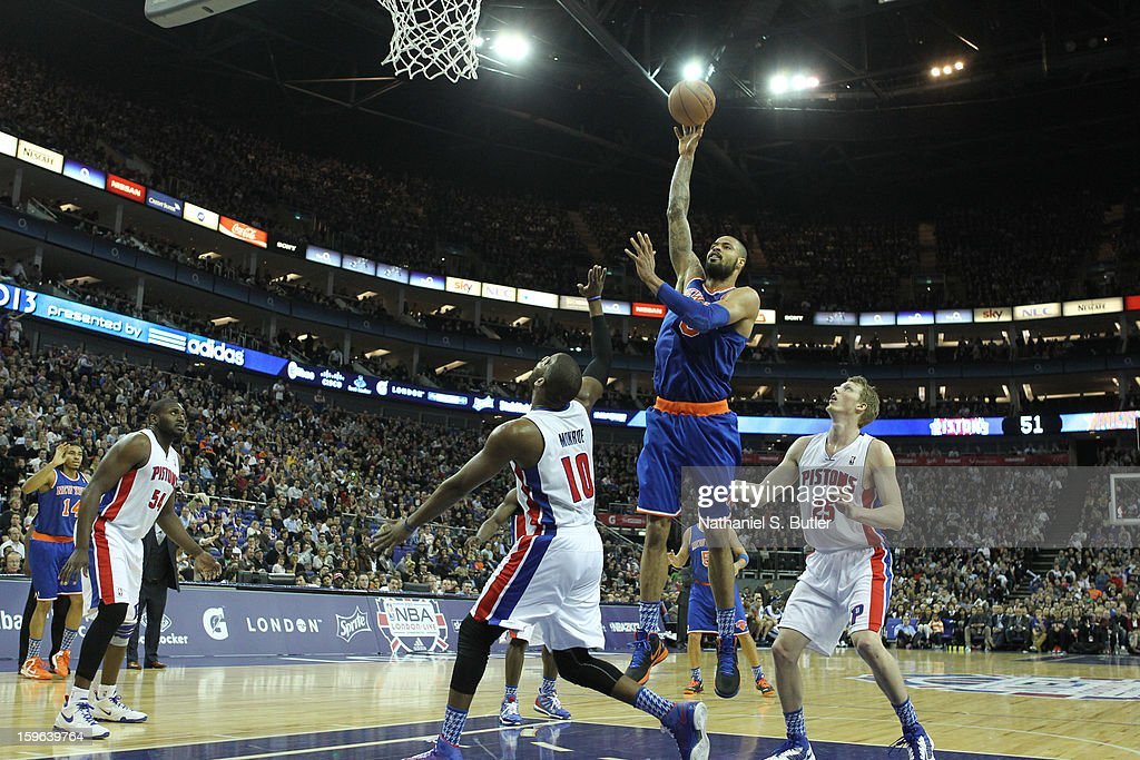 Tyson Chandler #6 of the New York Knicks shoots over Greg Monroe #10 of the Detroit Pistons during a game between the New York Knicks and the Detroit Pistons at the 02 Arena on January 17, 2013 in London, England.