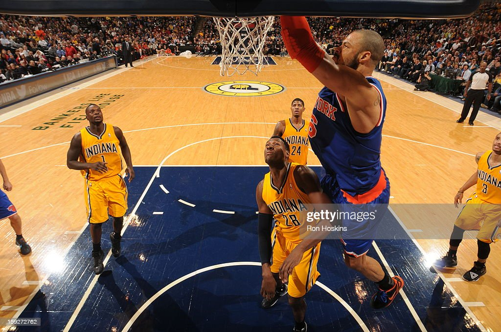 <a gi-track='captionPersonalityLinkClicked' href=/galleries/search?phrase=Tyson+Chandler&family=editorial&specificpeople=202061 ng-click='$event.stopPropagation()'>Tyson Chandler</a> #6 of the New York Knicks slams the ball home against the Indiana Pacers on January 10, 2013 at Bankers Life Fieldhouse in Indianapolis, Indiana.