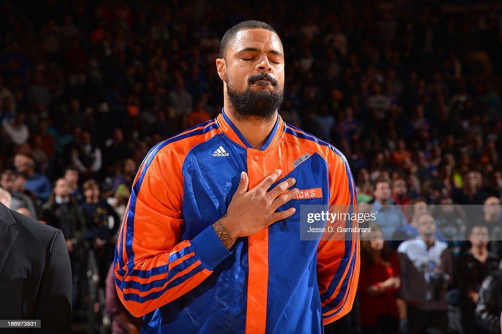 Tyson Chandler #6 of the New York Knicks stands for the anthem against the Minnesota Timberwolves on November 3, 2013 at Madison Square Garden in New York City, New York.