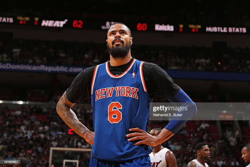 <a gi-track='captionPersonalityLinkClicked' href=/galleries/search?phrase=Tyson+Chandler&family=editorial&specificpeople=202061 ng-click='$event.stopPropagation()'>Tyson Chandler</a> #6 of the New York Knicks stands on the court during the game against the Miami Heat on April 2, 2013 at American Airlines Arena in Miami, Florida.