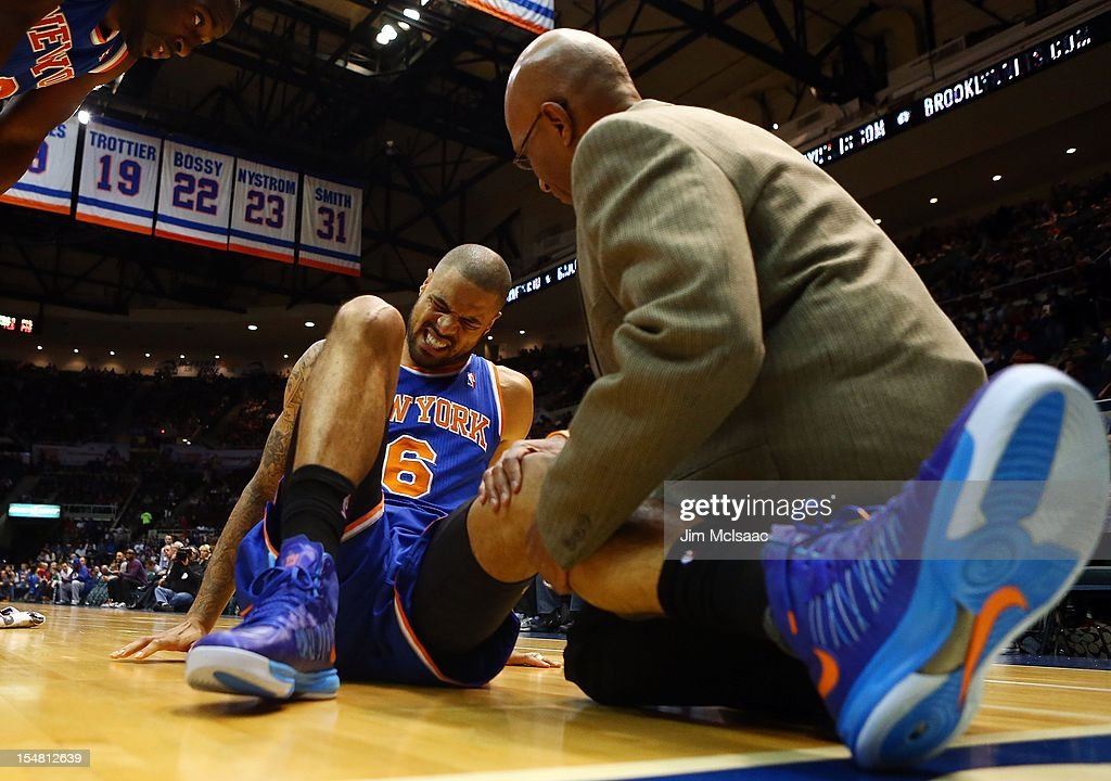 Tyson Chandler #6 of the New York Knicks suffers a knee injury against the Brooklyn Nets during a preseason game at Nassau Coliseum on October 24 2012 in Uniondale, New York The Knicks defeated the Nets 97-95.