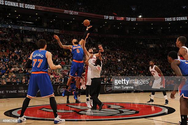 Tyson Chandler of the New York Knicks tips off the game against the Toronto Raptors on December 28 2013 at the Air Canada Centre in Toronto Ontario...