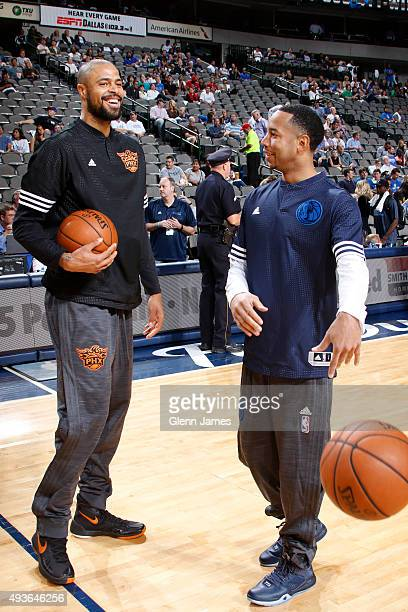 Tyson Chandler of the Phoenix Suns and Devin Harris of the Dallas Mavericks before a game on October 21 2015 at the American Airlines Center in...