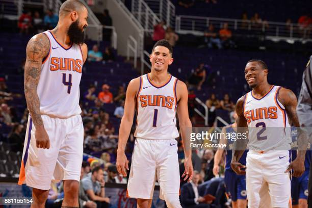 Tyson Chandler of the Phoenix Suns Devin Booker of the Phoenix Suns and Eric Bledsoe of the Phoenix Suns react during the preseason game against the...