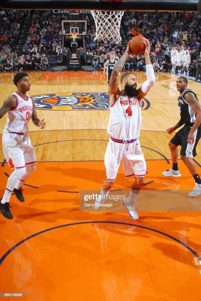 Tyson Chandler #4 of the Phoenix Suns grabs a rebound against the San Antonio Spurs on December 9, 2017 at Talking Stick Resort Arena in Phoenix, Arizona.