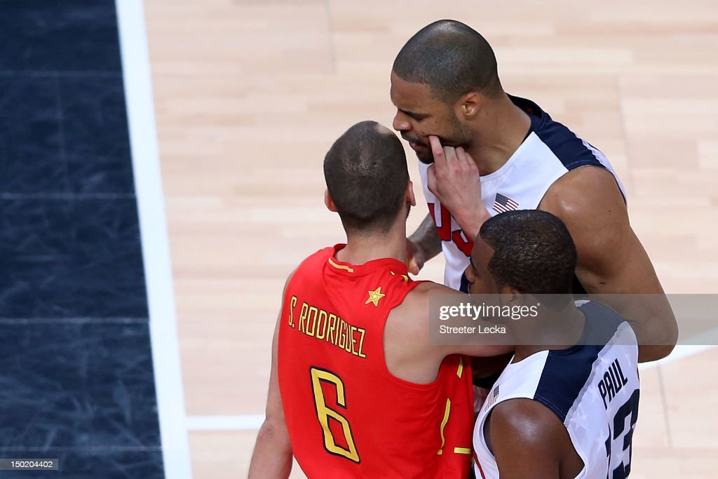 <a gi-track='captionPersonalityLinkClicked' href=/galleries/search?phrase=Tyson+Chandler&family=editorial&specificpeople=202061 ng-click='$event.stopPropagation()'>Tyson Chandler</a> #4 of the United States reacts after clashing with <a gi-track='captionPersonalityLinkClicked' href=/galleries/search?phrase=Sergio+Rodriguez&family=editorial&specificpeople=765161 ng-click='$event.stopPropagation()'>Sergio Rodriguez</a> #6 of Spain during the Men's Basketball gold medal game between the United States and Spain on Day 16 of the London 2012 Olympics Games at North Greenwich Arena on August 12, 2012 in London, England.