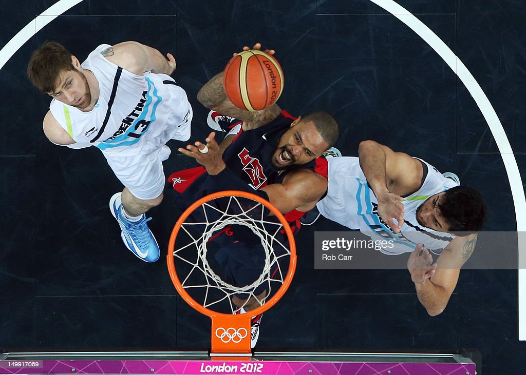 <a gi-track='captionPersonalityLinkClicked' href=/galleries/search?phrase=Tyson+Chandler&family=editorial&specificpeople=202061 ng-click='$event.stopPropagation()'>Tyson Chandler</a> #4 of United States goes to the hoop against <a gi-track='captionPersonalityLinkClicked' href=/galleries/search?phrase=Andres+Nocioni&family=editorial&specificpeople=201854 ng-click='$event.stopPropagation()'>Andres Nocioni</a> #13 and <a gi-track='captionPersonalityLinkClicked' href=/galleries/search?phrase=Carlos+Delfino&family=editorial&specificpeople=206625 ng-click='$event.stopPropagation()'>Carlos Delfino</a> #10 of Argentina during the Men's Basketball Preliminary Round match on Day 10 of the London 2012 Olympic Games at the Basketball Arena on August 6, 2012 in London, England.