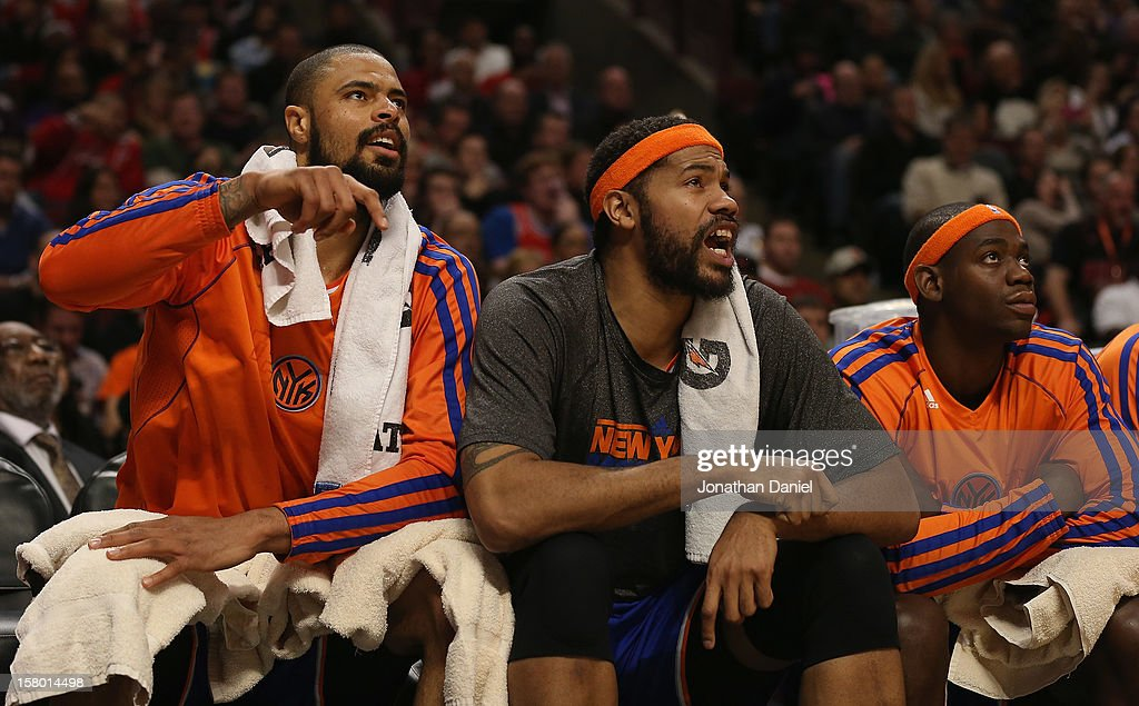 Tyson Chandler #6, Rasheed Wallace #36 and Ronnie Brewer #11 of the New York Knicks watch from the bench as their teammates take on the Chicago Bulls at the United Center on December 8, 2012 in Chicago, Illinois. The Bulls defeated the Knicks 93-85.