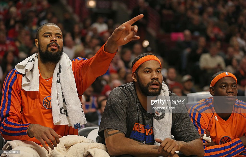 Tyson Chandler #6, Rasheed Wallace #36 and Ronnie Brewer #11 of the New York Knicks watch from the bench as teammates take on the Chicago Bulls at the United Center on December 8, 2012 in Chicago, Illinois. The Bulls defeated the Knicks 93-85.