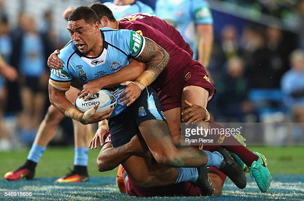 Tyson Frizell of the Blues is tackled during game three of the State Of Origin series between the New South Wales Blues and the Queensland Maroons at...