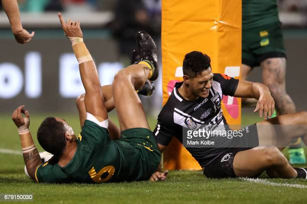 Tyson Frizell of the Kangaroos celebrates scoring a try as Roger TuivasaSheck of the Kiwis looks dejected during the ANZAC Test match between the...