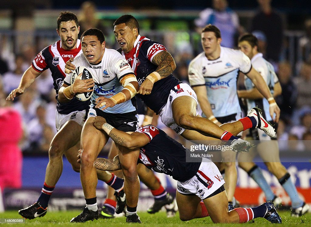 Tyson Frizell of the Sharks is tackled during the round 18 NRL match between the Cronulla Sharks and the Sydney Roosters at Toyota Stadium on July 9...