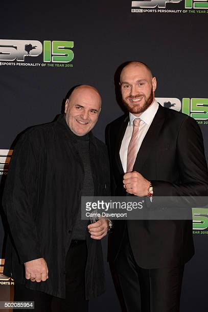 Tyson Fury and his father pose on the red carpet before the BBC Sports Personality of the Year award at Odyssey Arena on December 20 2015 in Belfast...
