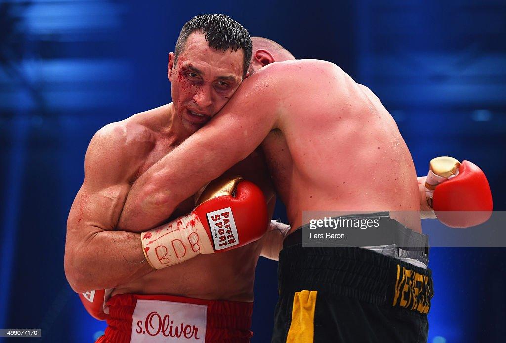 Tyson Fury and Wladimir Klitschko clinch during the IBF IBO WBA WBO Heavyweight World Championship contest at EspritArena on November 28 2015 in...