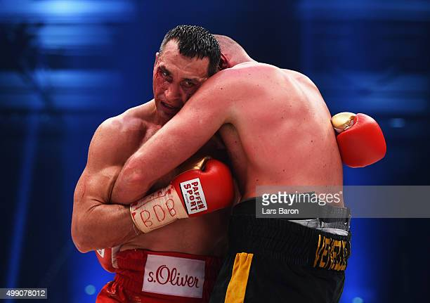 Tyson Fury and Wladimir Klitschko clinch during the IBF IBO WBA WBO Heavyweight World Championship contest at EspritArena on November 28 2015 in...
