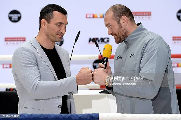 Tyson Fury and Wladimir Klitschko react during their head to head press conference on April 28 2016 in Cologne Germany Fury v Klitschko Part 2 will...