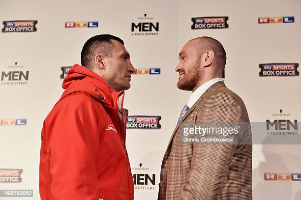 Tyson Fury and Wladimir Klitschko stare off during a press conference at Rheinterassen on November 24 2015 in Duesseldorf Germany