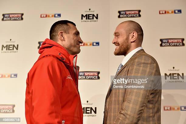 Tyson Fury and Wladimir Klitschko stare off during a press conference at Rheinterassen on November 24 2015 in Duesseldorf Germany