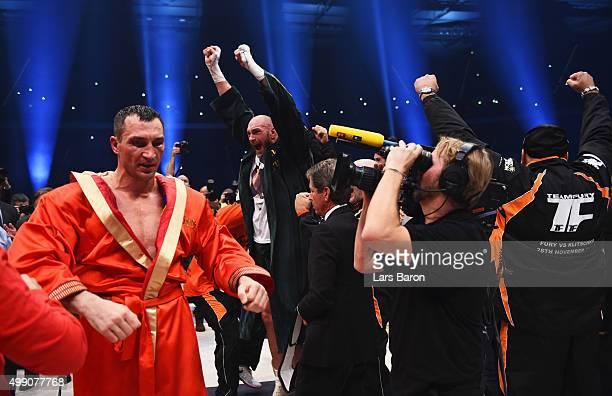 Tyson Fury celebrates as he defeats Wladimir Klitschko to become new World Heavyweight Champion during the IBF IBO WBA WBO Heavyweight World...