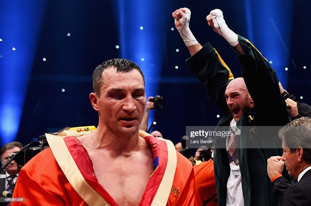 Tyson Fury (R) celebrates as he defeats Wladimir Klitschko (L) to become new World Heavyweight Champion during the IBF IBO WBA WBO Heavyweight World Championship contest at Esprit-Arena on November 28, 2015 in Duesseldorf, Germany..