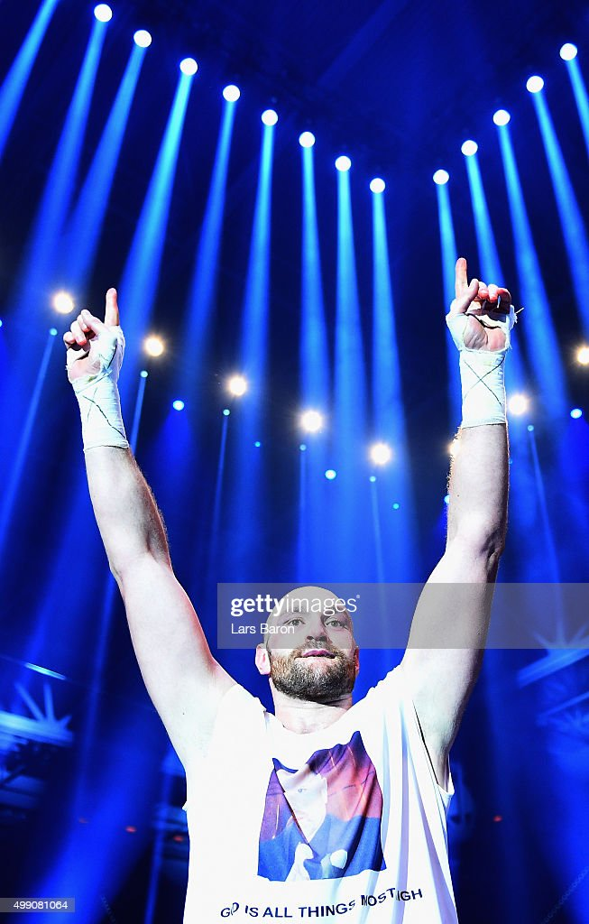 Tyson Fury celebrates as he defeats Wladimir Klitschko to become new World Heavyweight Champion after the IBF IBO WBA WBO Heavyweight World Championship contest at Esprit-Arena on November 28, 2015 in Duesseldorf, Germany.