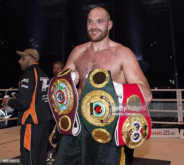 Tyson Fury celebrates his victory over Ukraine's Vladimir Klitschko after IBF/IBO/WBA/WBO World Heavyweight title bout at the Esprit Arena in...