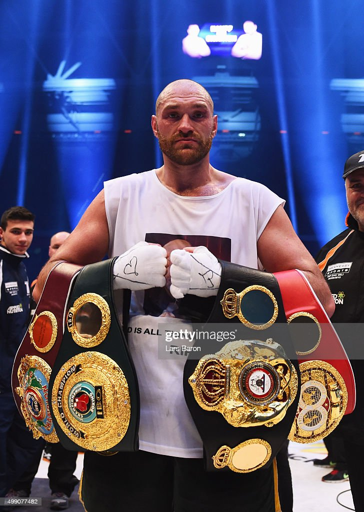 Tyson Fury celebrates with belts as he defeats Wladimir Klitschko to become new World Heavyweight Champion after the IBF IBO WBA WBO Heavyweight World Championship contest at Esprit-Arena on November 28, 2015 in Duesseldorf, Germany.