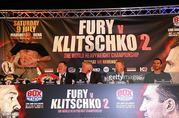 Tyson Fury faces the media bare chested during a press conference ahead of his fight with Wladimir Klitschko at the Manchester Arena on April 27 2016...