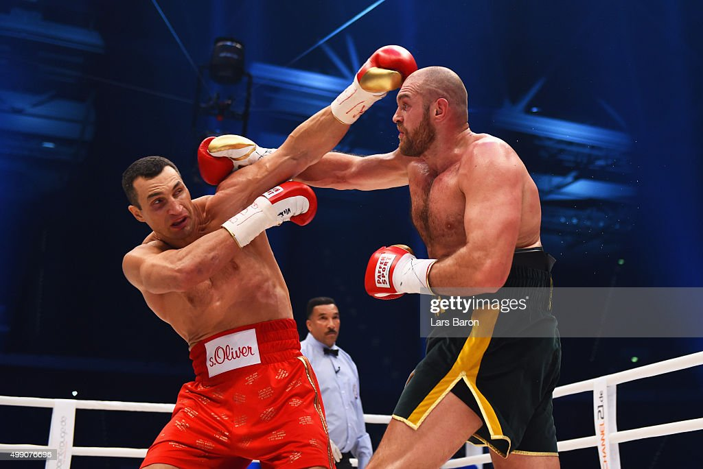 Tyson Fury in action with Wladimir Klitschko during the IBF IBO WBA WBO Heavyweight World Championship contest at Esprit-Arena on November 28, 2015 in Duesseldorf, Germany.