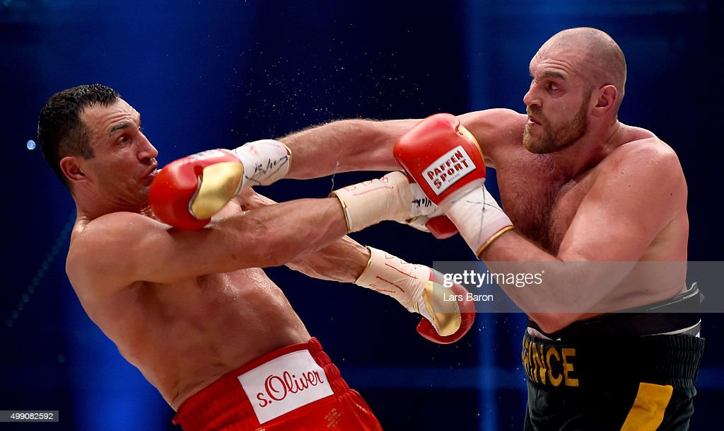 Tyson Fury in action with Wladimir Klitschko during their IBF/IBO/WBA/WBO World Heavyweight Championship title fight at Esprit-Arena on November 28, 2015 in Duesseldorf, Germany.