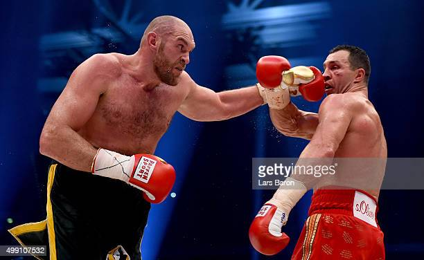 Tyson Fury in action with Wladimir Klitschko during their IBF/IBO/WBA/WBO World Heavyweight Championship title fight at EspritArena on November 28...