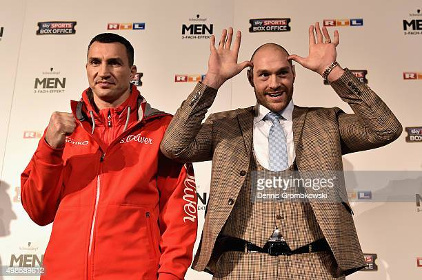 Tyson Fury jokes next to Wladimir Klitschko as they have their stare off during a press conference at Rheinterassen on November 24 2015 in...