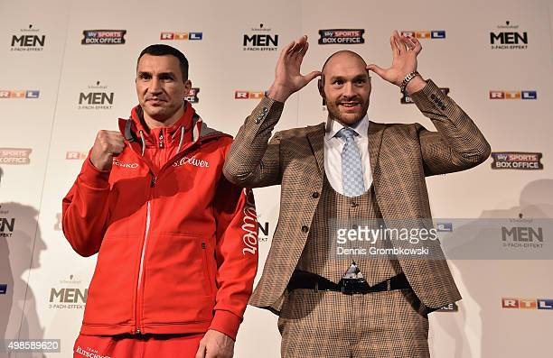 Tyson Fury jokes next to Wladimir Klitschko as they have their stare off during a press conference at Rheinterassen on November 24 2015 in...