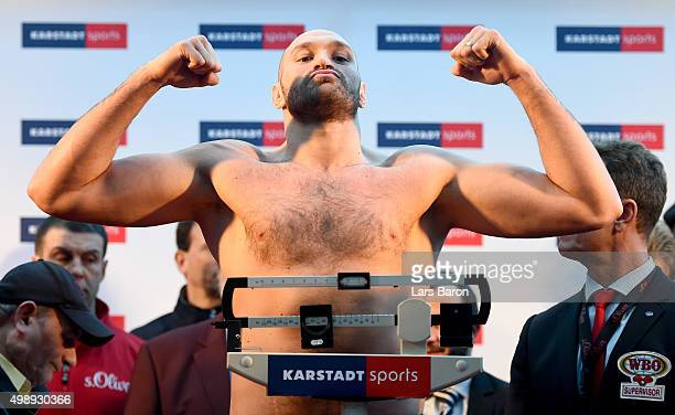 Tyson Fury of UK poses after the weigh in at Karstadt Sport on November 27 2015 in Essen Germany