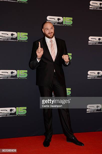 Tyson Fury poses on the red carpet before the BBC Sports Personality of the Year award at Odyssey Arena on December 20 2015 in Belfast Northern...