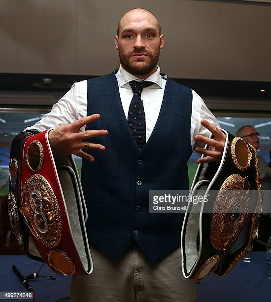 Tyson Fury poses with his belts following a press conference at the Macron Stadium on November 30 2015 in Bolton England