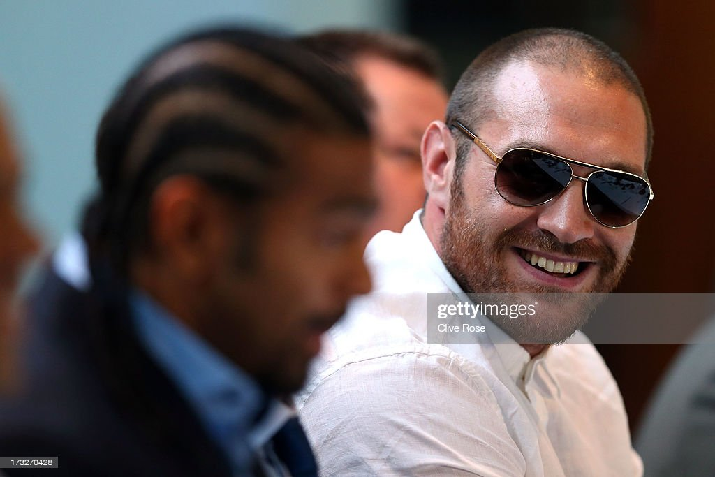 Tyson Fury (R) speaks beside David Haye during a press conference to announce their upcoming title fight on July 11, 2013 in London, England.