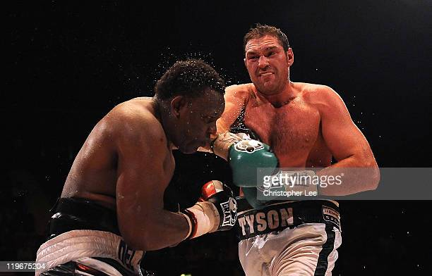 Tyson Fury throws a punch at Dereck Chisora during the British Commonwealth Heavyweight Title Fight between Dereck Chisora and Tyson Fury at Wembley...