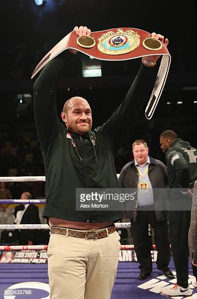 Tyson Fury with the WBO Heavyweight Championship belt after the vacant WBO Intercontinental Heavyweight Championship contest between Hughie Fury and...