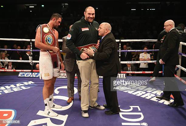 Tyson Fury with the WBO Heavyweight Championship belt as Hughie Fury looks on after the vacant WBO Intercontinental Heavyweight Championship contest...