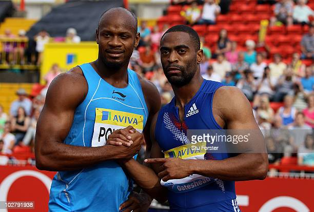Tyson Gay and Asafa Powell celebrate after the mens 100 metres final during the Aviva British Grand Prix at Gateshead International Stadium on July...