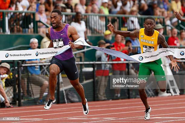 Tyson Gay crosses the finish line ahead of Trayvon Bromell to win the Men's 100 Meter Dash Final during day two of the 2015 USA Outdoor Track Field...
