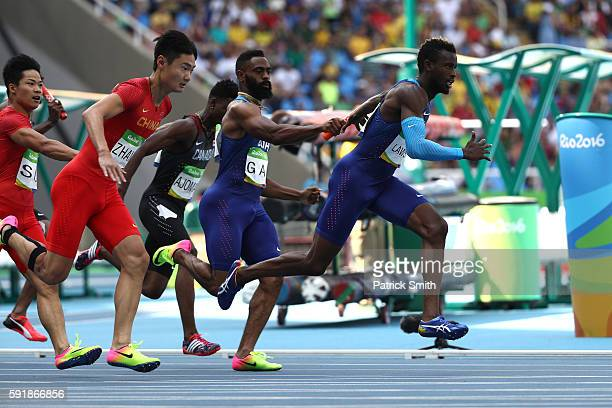 Tyson Gay hands the baton to Jarrion Lawson of the United States during round one of the Men's 4 x 100m Relay on Day 13 of the Rio 2016 Olympic Games...